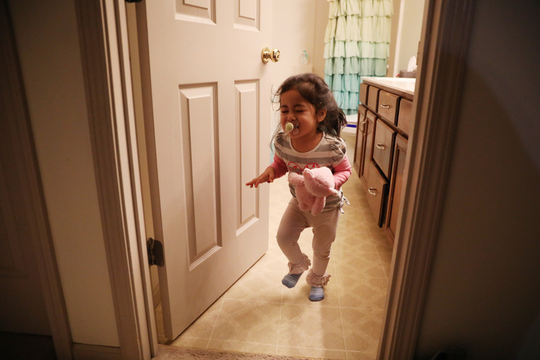 Jane Fulcher runs out of bathroom while playing hide-and-seek with her brother, Arthur, on Thursday, November 28, 2019 in Columbia, Missouri.