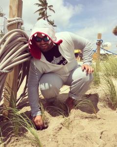 Gabe planting sea oats at Tortuga Music Festival