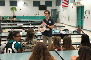 Amy teaching Girls Scouts about Sharks