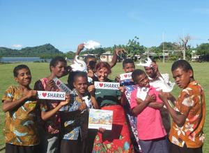 Angela teaching kids in Fiji about sharks