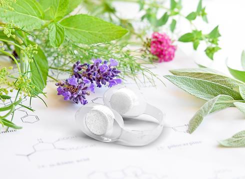 Thera-Clip essential oil inhaler on floral background