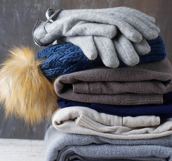 stack-of-warm-knitted-clothes-ZM3DGJL.jp
