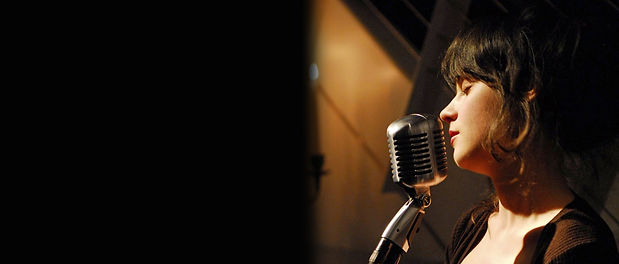 zooey_deschanel_microphone_wall_by_maul5