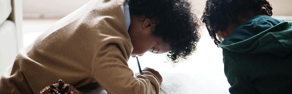 kids-enjoying-coloring-book@2x.png