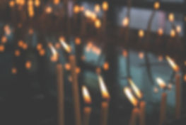 Abstract photo of candles in room