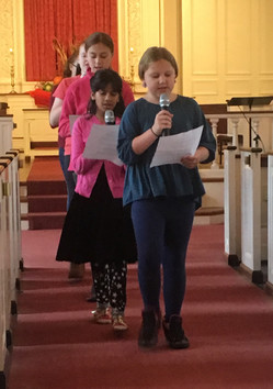 Singing down the aisle during service