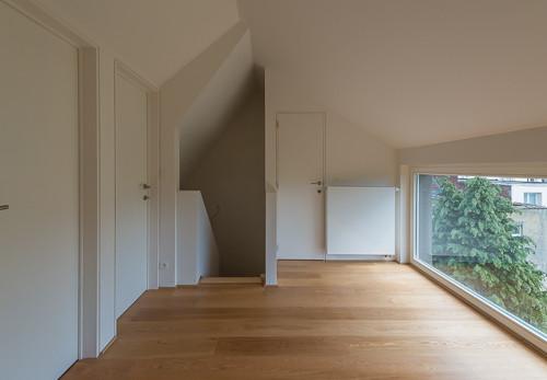 Surélévation contemporaine à Forest: réhausse maison bruxelloise
