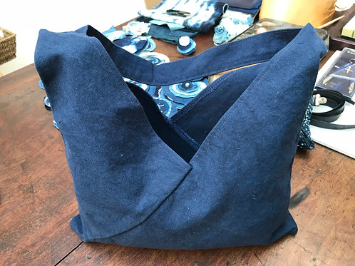 Basic indigo bag on natural fabric