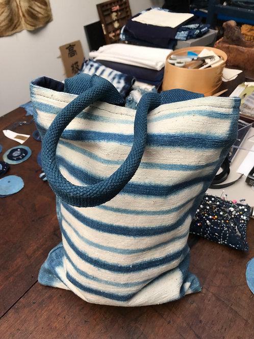 Striped shibori/indigo designed bag.