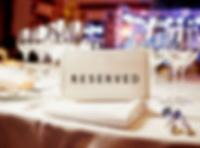 Reserved sign on a table in restaurant.j