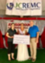 JCREMC Employees award a $1,000 check to Miss Johnson County 2019.