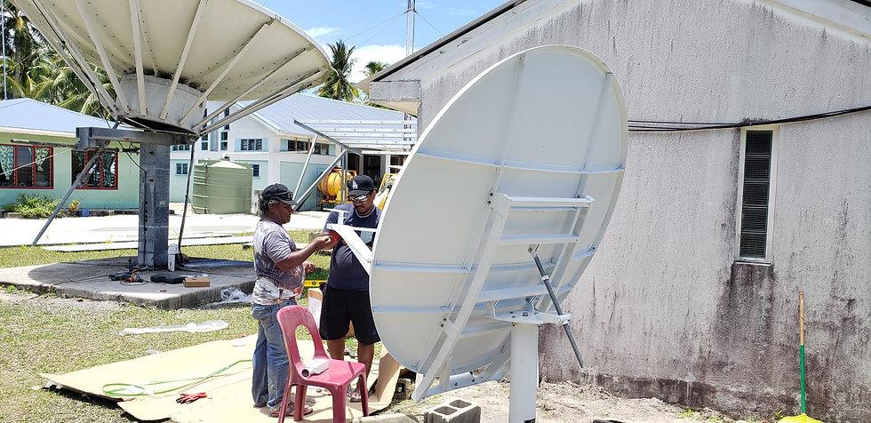 technical team installing 1.2 dish.jpg