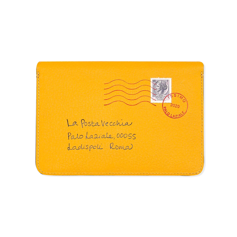 Passport holder envelope in mustard leather and embossed with the address of La Posta Vecchia hotel and with original stamps from 1960s Italy. Each address has been handwritten by one of the Sciò's family.