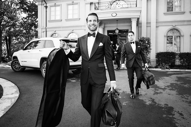 Groom and groomsman wearing bespoke tuxedos handmade in Toronto by MICHEL'S BESPOKE