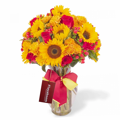 Renacer Rojo - Arreglo floral en florero con girasoles y rosas rojas