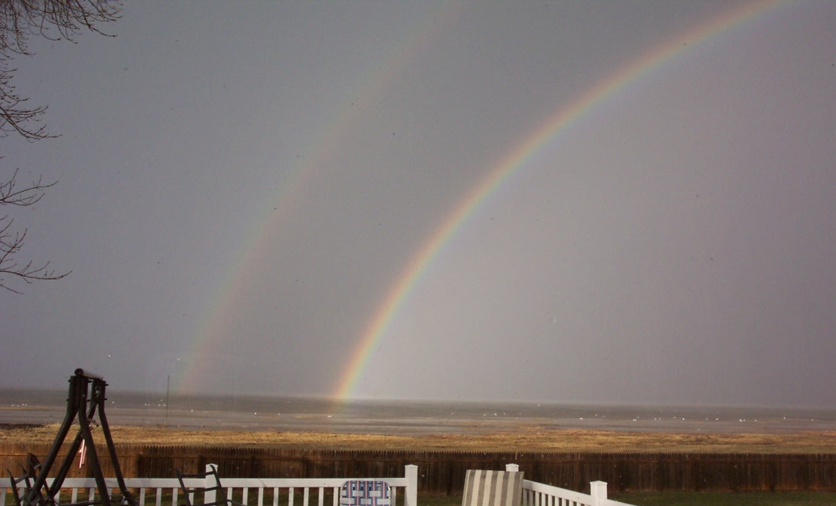 Double rainbow over the water.JPG