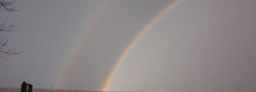 Double rainbow over the water.JPG