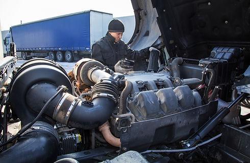 Mechanic repairing truck.jpg