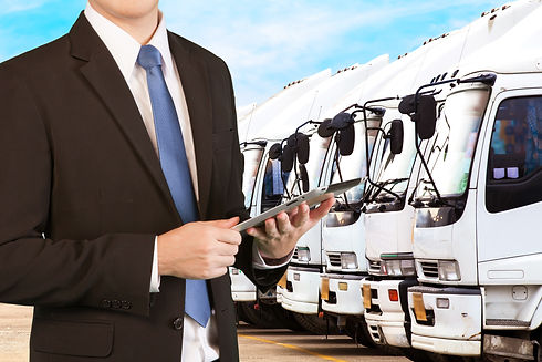 Businessman holding tablet standing over