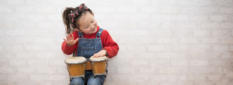 Toddler Playing Bongos