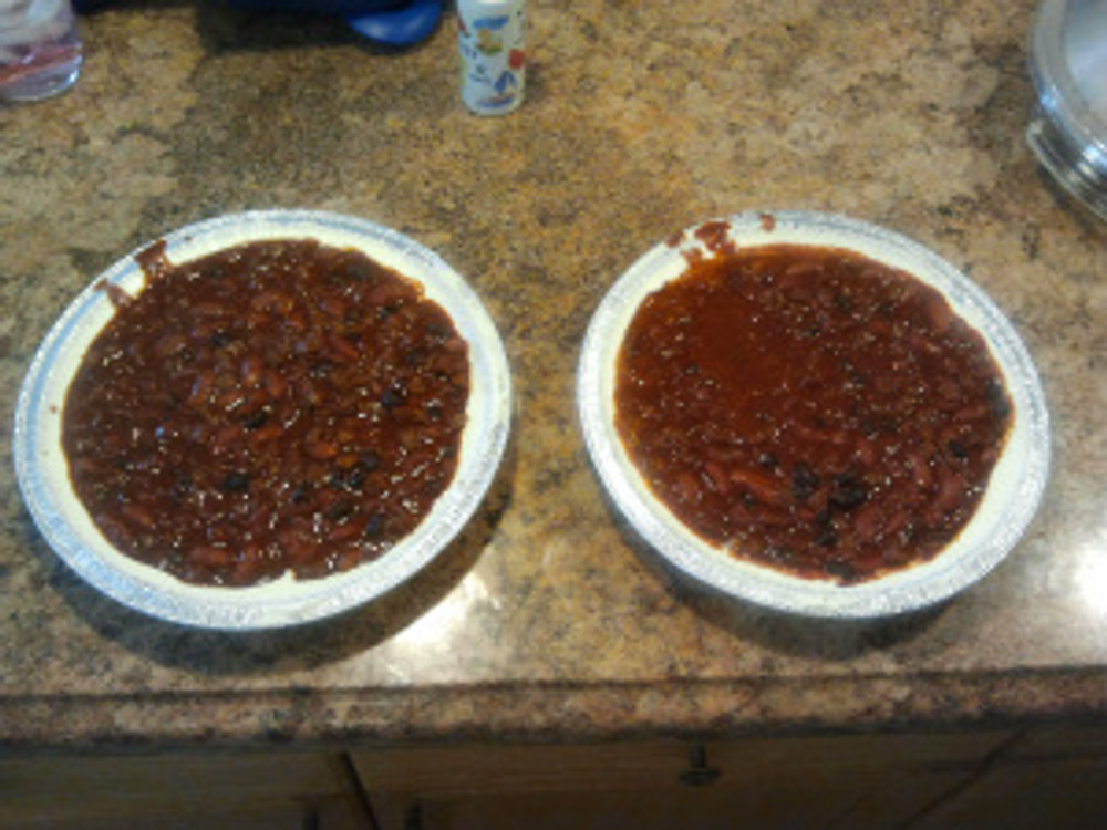 "Line a 9"" pie tin evenly on sides and bottom with room temp cream cheese then add about 1/2"" to 3/4"" of chili, fill to about a 1/4"" from top of tin"