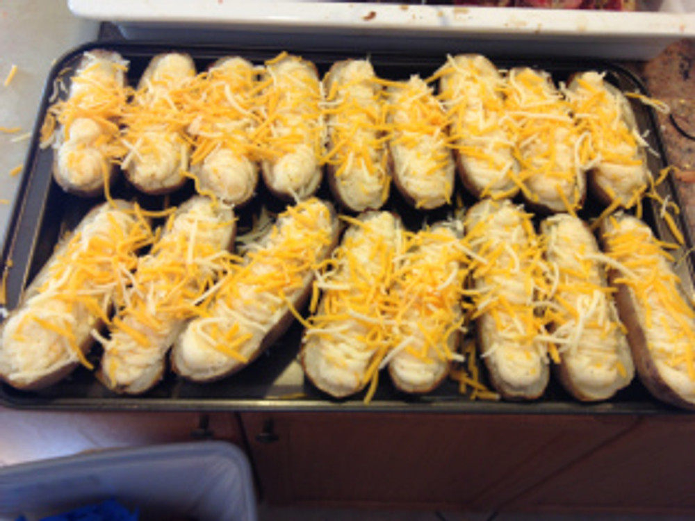 When they are all filled, top with a light layer of the cheese and bake for 20 to 30 minutes aat 350 or until the cheese is melted and they are heated through...and eat'm up