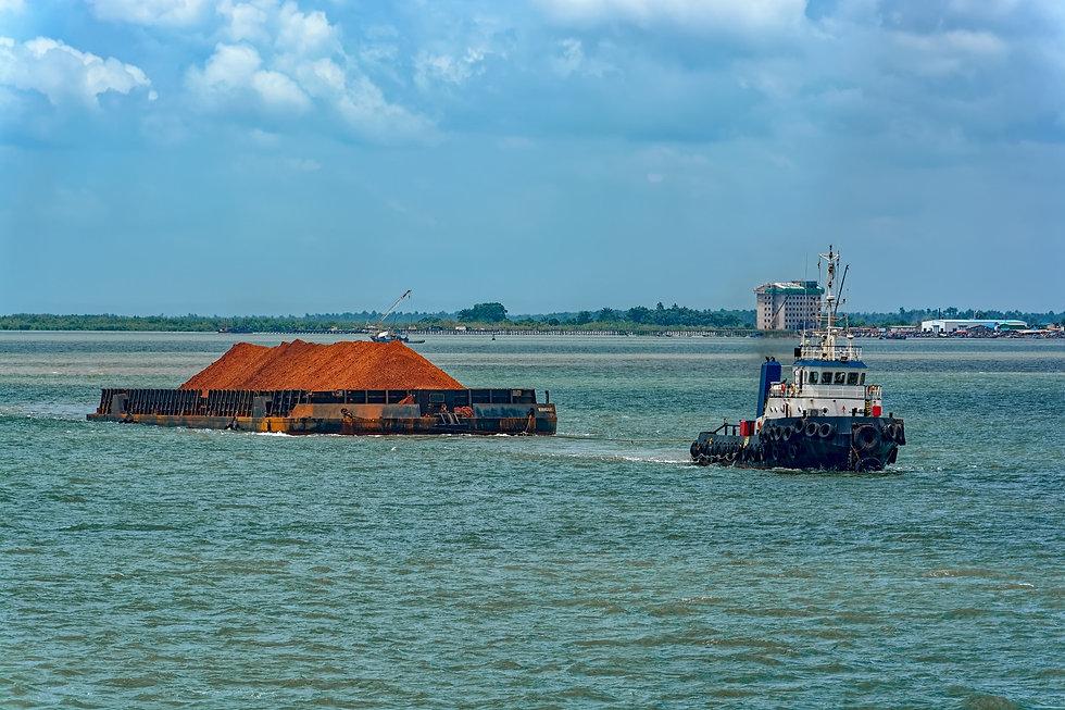Tug Boat Towing Barge