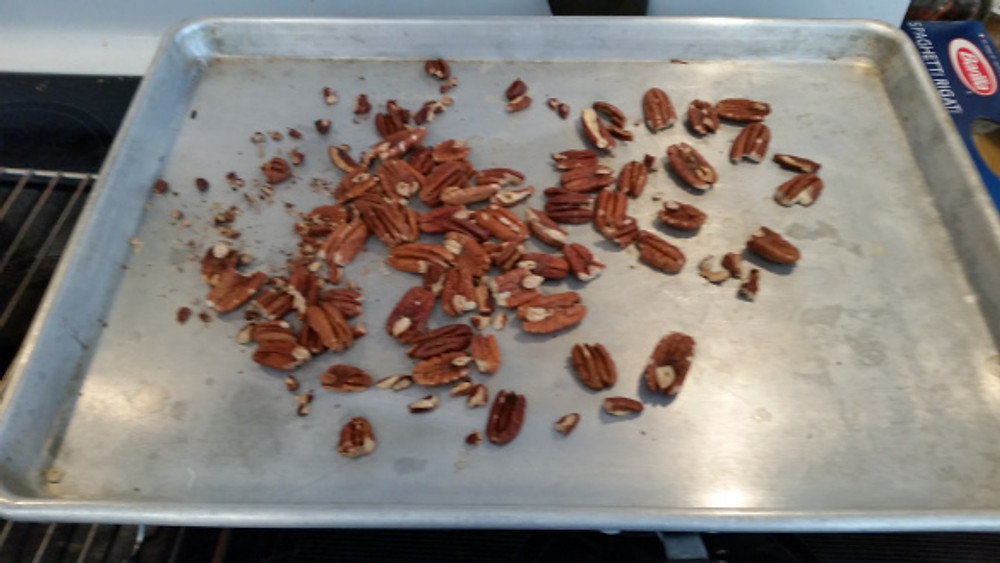 Take a cup of pecans (or what ever damn nuts you want...and no, not those nuts either) and bake'm at 350 degrees for 8 to 10 minutes until they brown a bit and ya can smell'm
