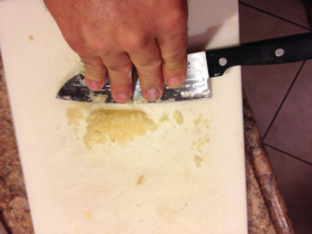 use 3 to 6 cloves of garlic smashed, diced and then smushed by pressing on the back of the blade while pulling across the garlic making it a smooth paste