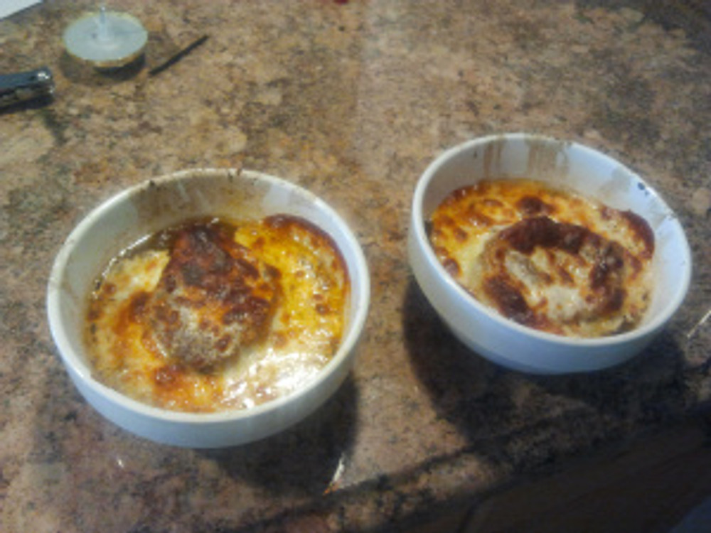 """Scoop onions into a bowl, place toasted french bread on top ad pour on soup liquid until about 1/2"""" from top and top with cheese (provolone works good) and bake for 5 minutes at 400 (or just give it a quick broil to melt and brown cheese)"""