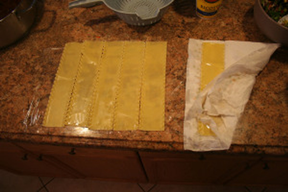 "par cook 6 lasagna noodles, pat dry with a paper towel and place tight together on saran wrap start noodles about 1"" up from bottom of wrap so you can roll it easier."