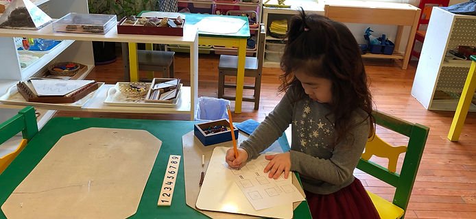 Preschooler Working on Math