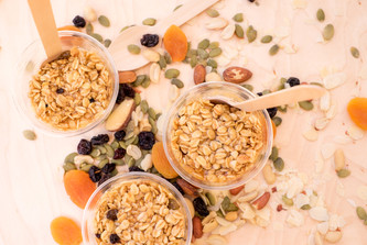 Greek style yoghurt pots with muesli, honey mixed berrries and nuts