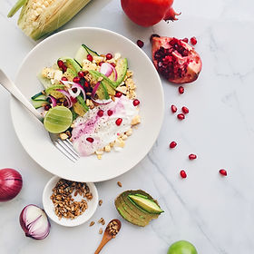 Plate of colorful healthy salad with avo