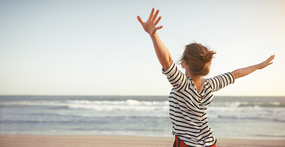 happy young woman enjoying freedom with