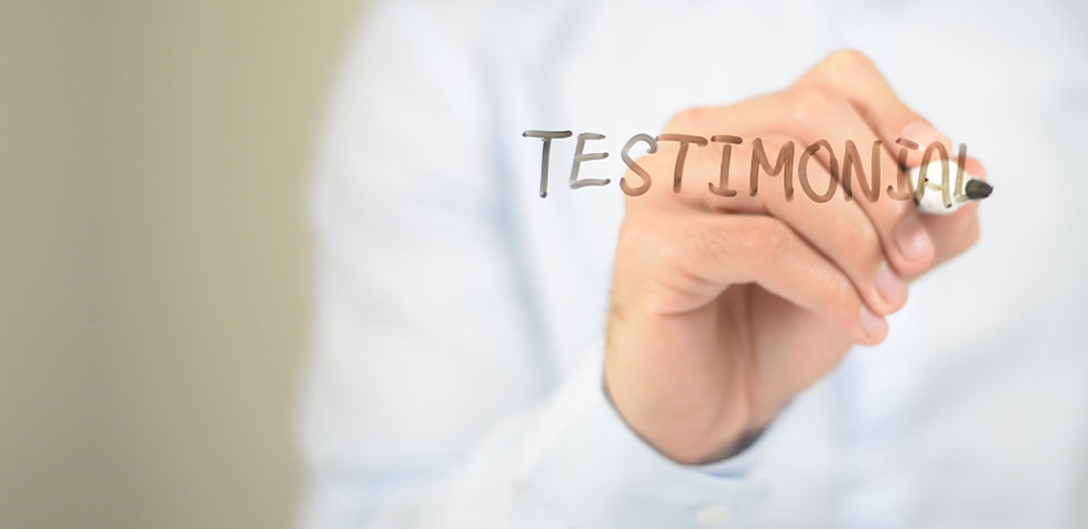 Hand writing the word Testimonials