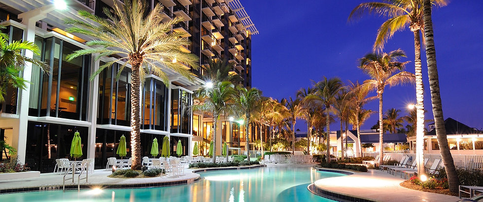 Large hotel with balconies overlooking pool