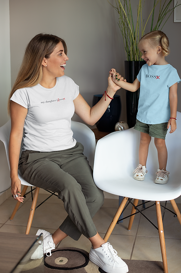 Mother and daughter in feminist t-shirts holding hands and laughing