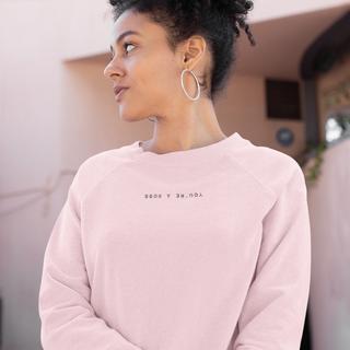 Woman in a pink feminist sweatshirt