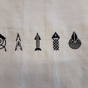 Linen fabric with folk embroidery symbols.