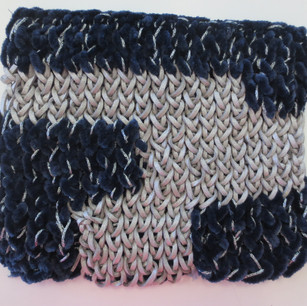 Knit with velvet yarn and leather cord.