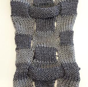 Knit in lurex and silk yarn.