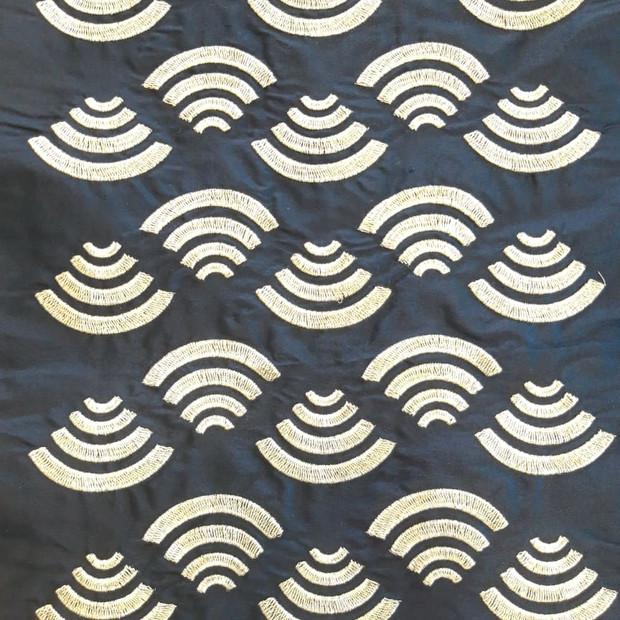 Silk fabric with silver thread.