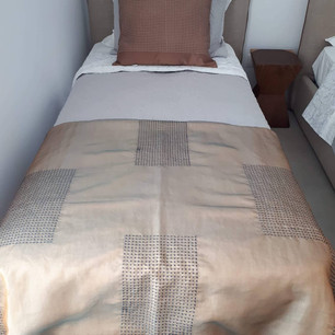 Embroidered organza throw and satin pillow.