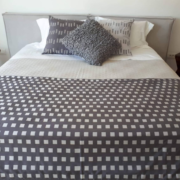 Guest Room 2-Handwoven linen throw with embroidered and knitted pillows.