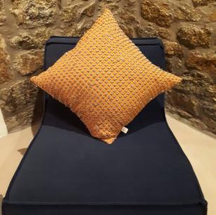 Linen pillow with silk cord.