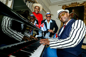 "Beside the Legendary Cuban Maestro, Evelio ""The Golden Voice"" Galan!"
