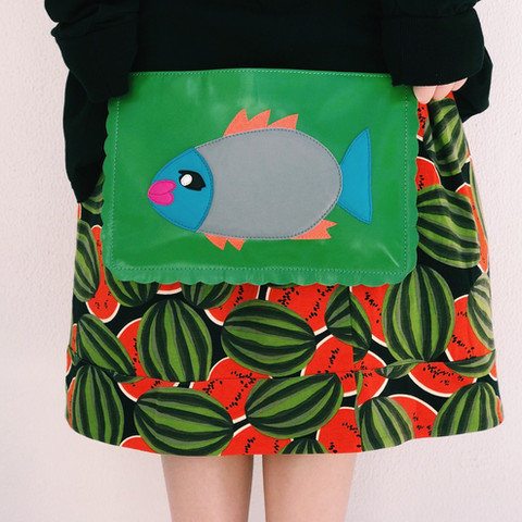 Leather clutch bag with applique
