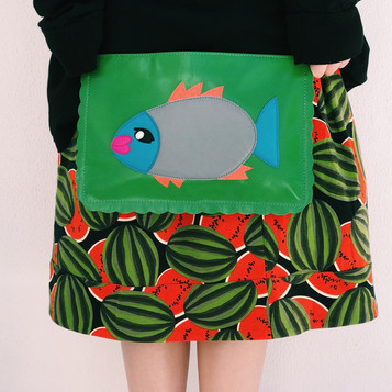 Leather clutch with applique