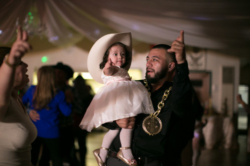 The Barrios family celebrates into the morning. Here Sophia imitates her uncle on the dance floor.